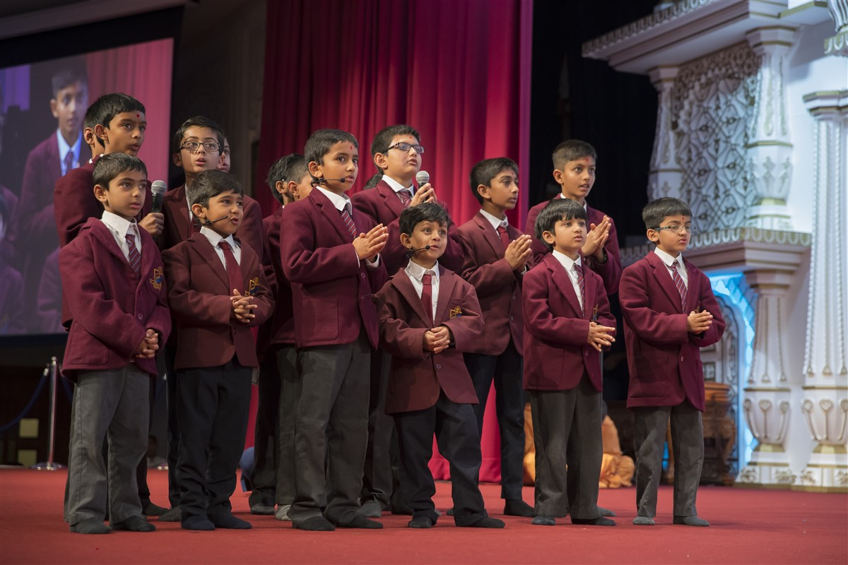 Pupils of The Swaminarayan School recite Sanskrit verses