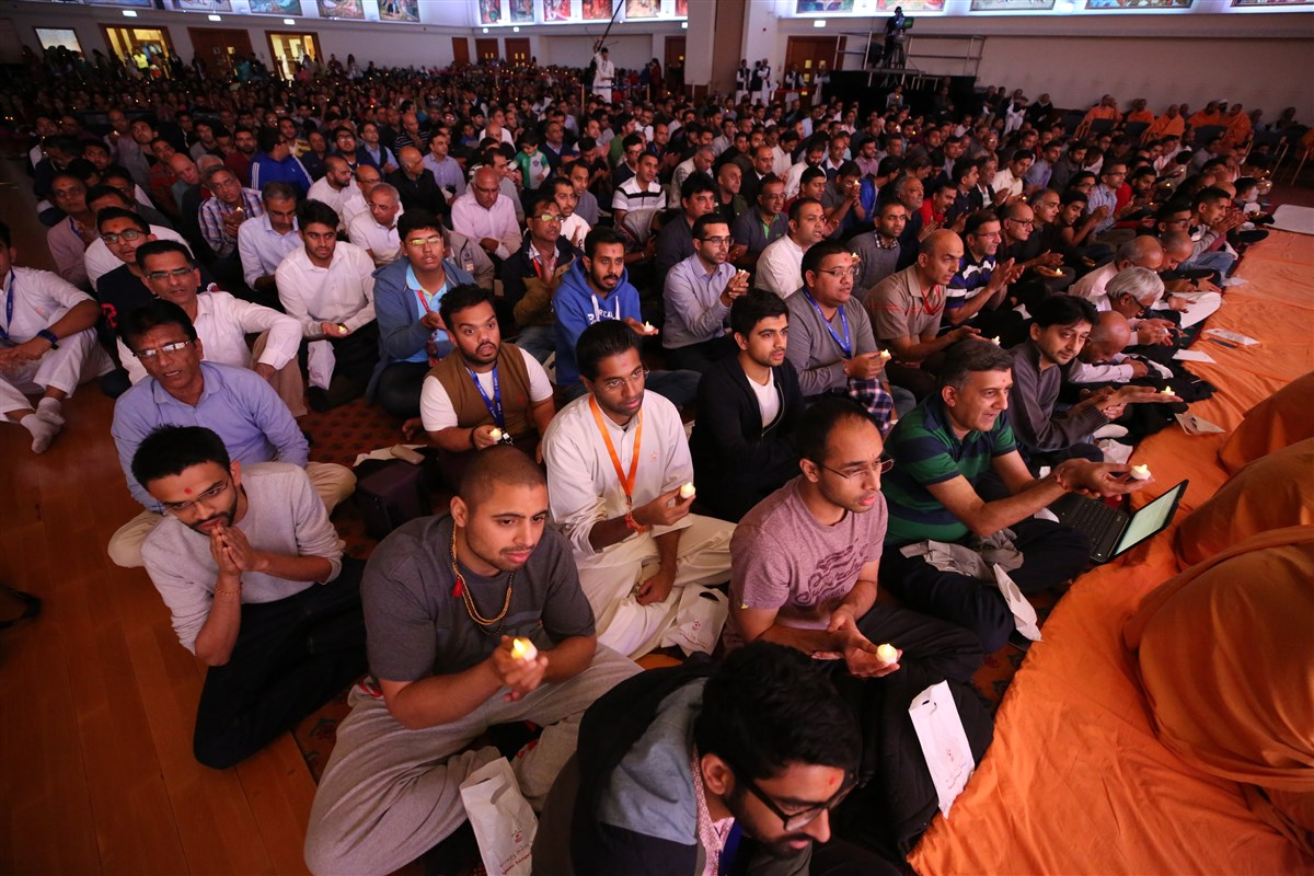 Devotees participate in the arti ceremony