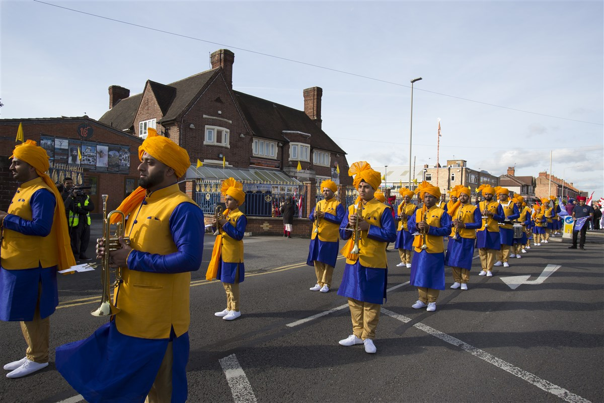 Leicester's Akshar Marching Band joins a grand street procession to welcome Swamishri to the city