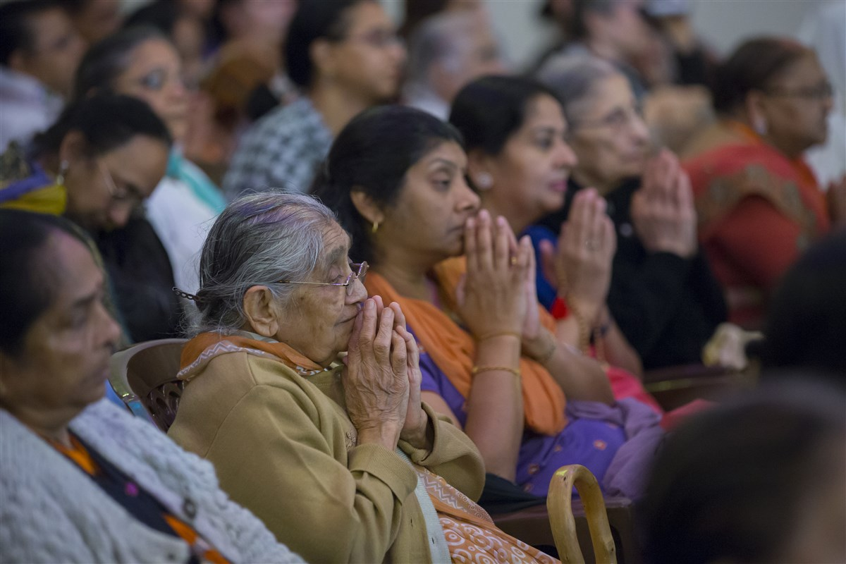 Devotees respond with folded hands