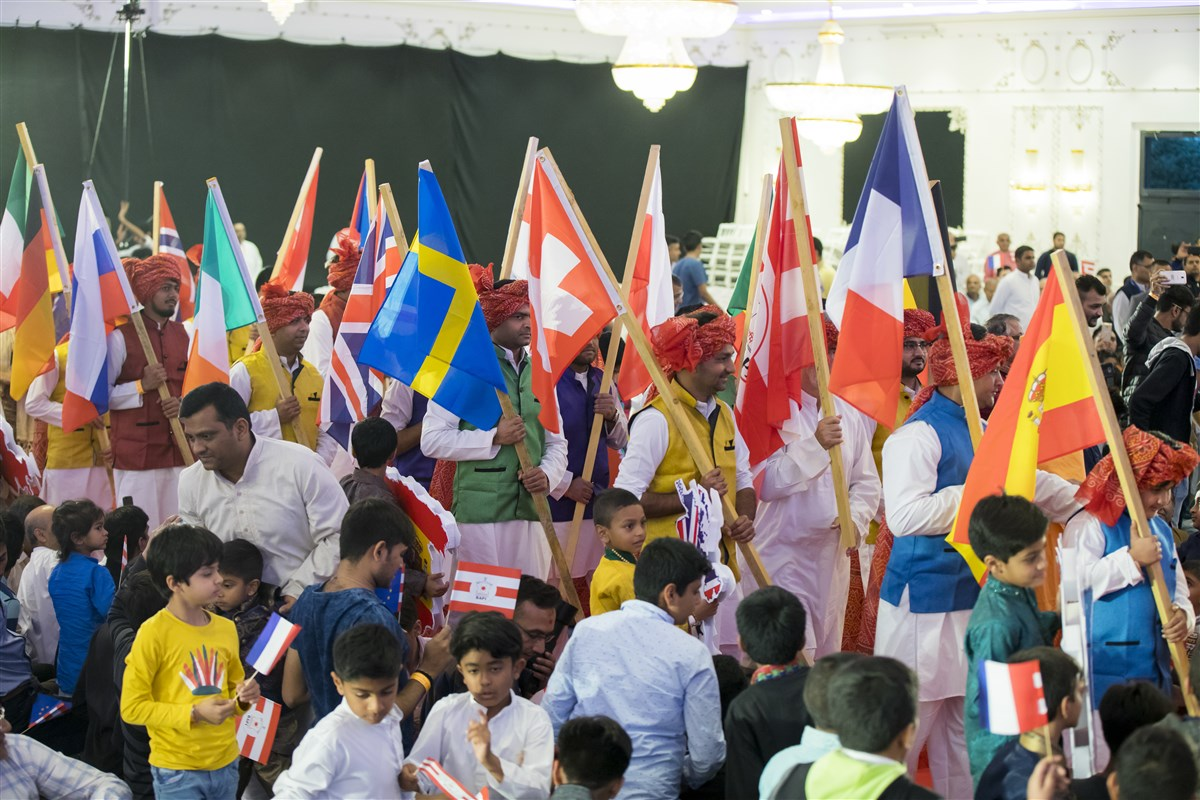 Representatives from several European countries join the welcome procession with Swamishri