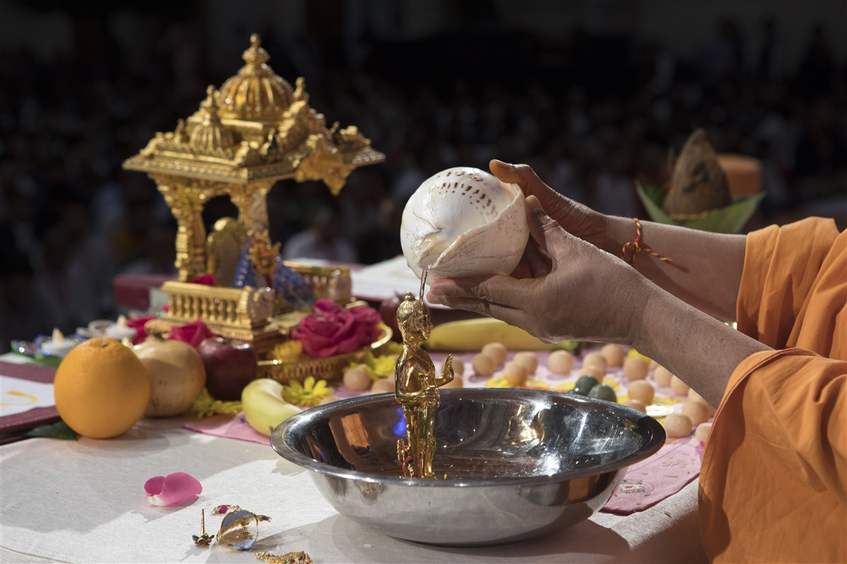 The ceremony involves the ritual bathing of Shri Harikrishna Maharaj