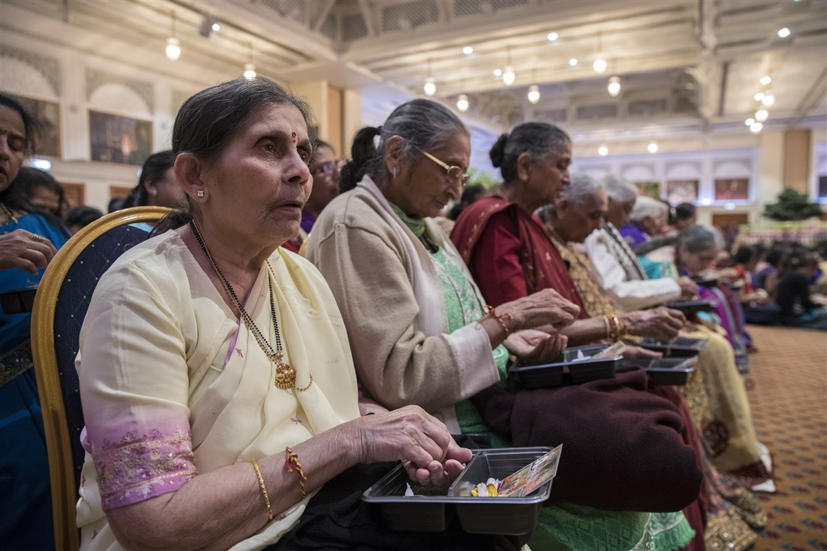 Devotees young and old participate in the chopda pujan ceremony