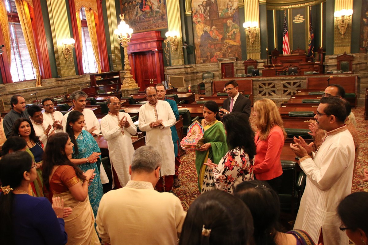 Members of the BAPS congregation recite a prayer for world peace in the House of Representatives.