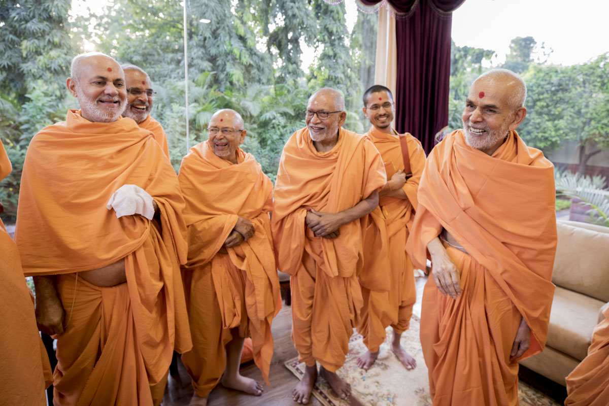 Swamishri in a divine, jovial moods with senior sadhus