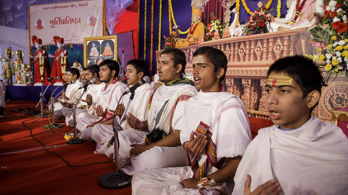 Youths chant Vedic mantras during the shilanyas mahapuja rituals