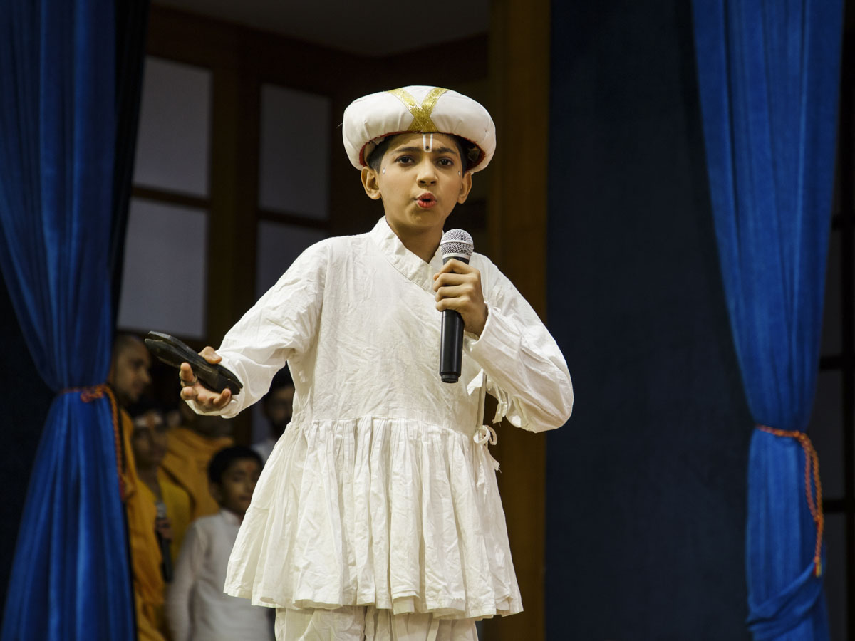 A child presents during the assembly