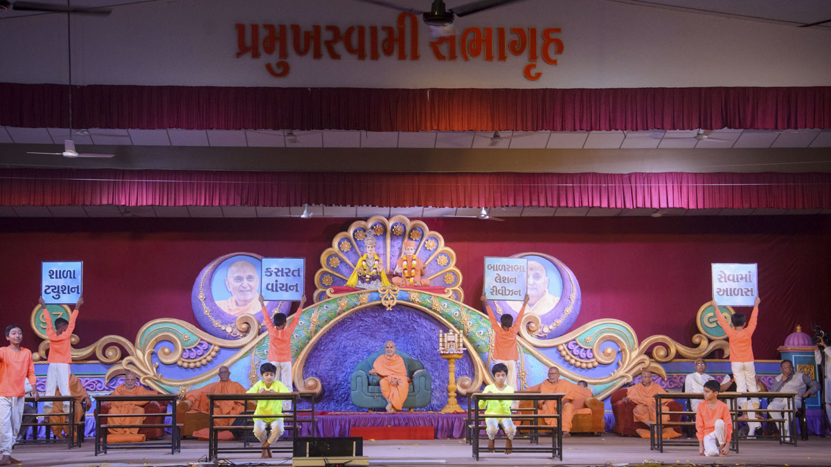 Students of Swaminarayan Vidyamandir, Bakrol, present a cultural program in the evening satsang assembly