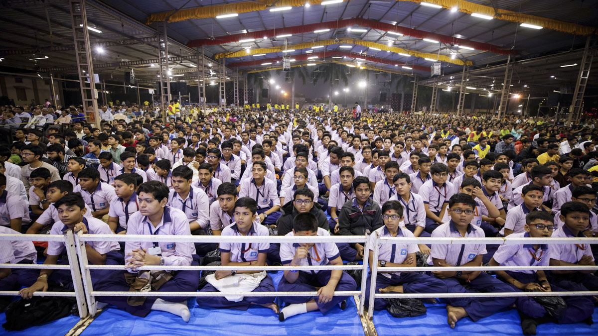 Students and devotees during the assembly