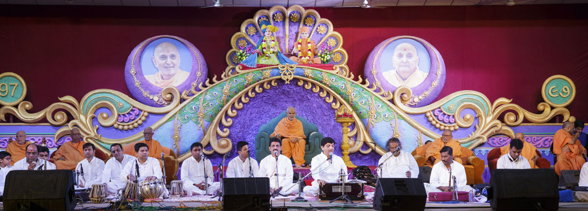 Youths present a kirtan aradhana in the evening satsang assembly