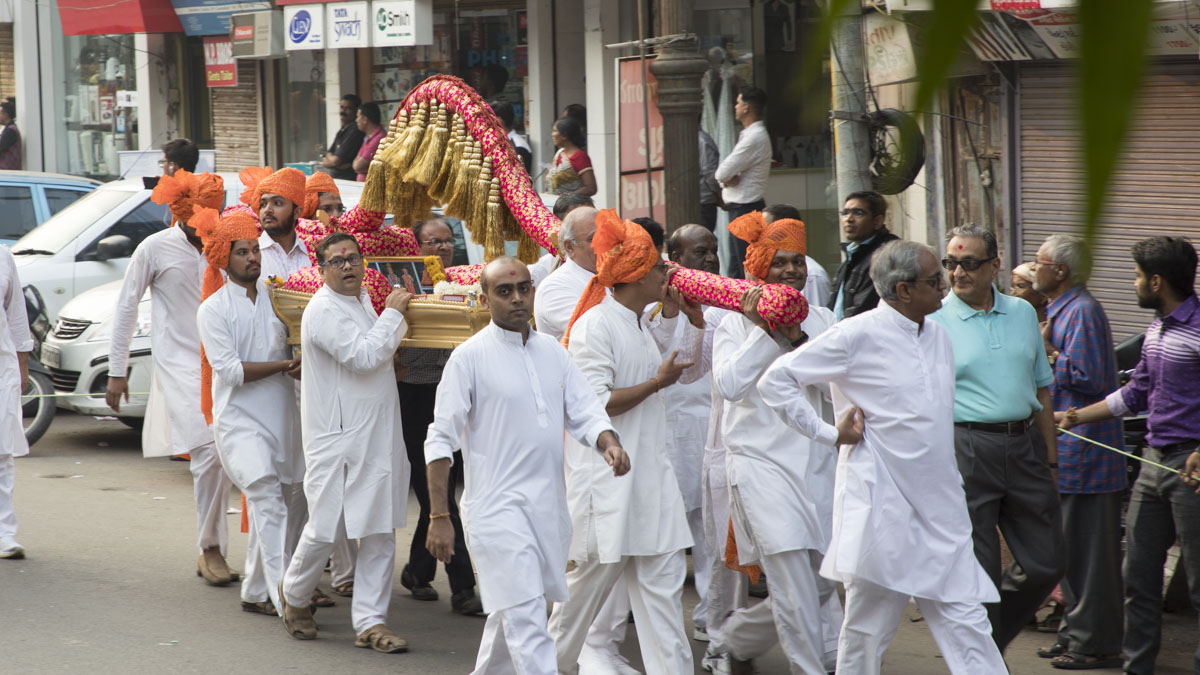 Devotees carry the bhashyas in a decorated palanquin