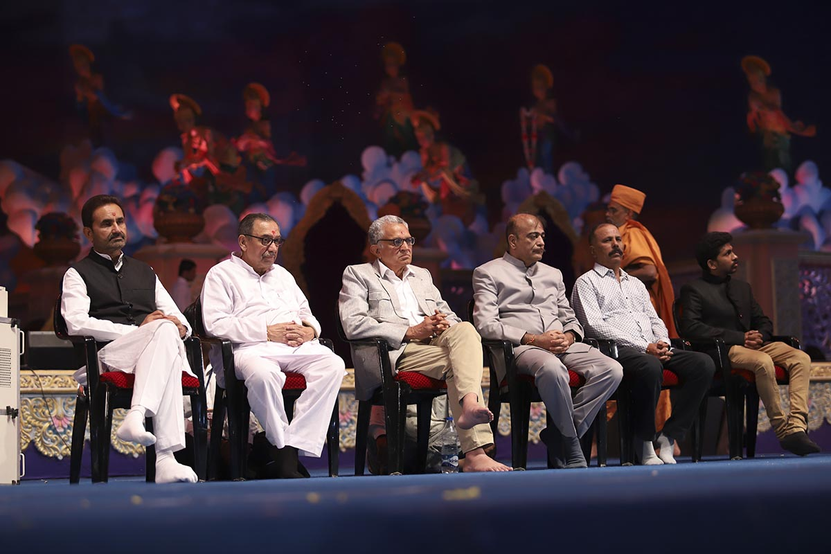 Dignitaries on stage during the assembly