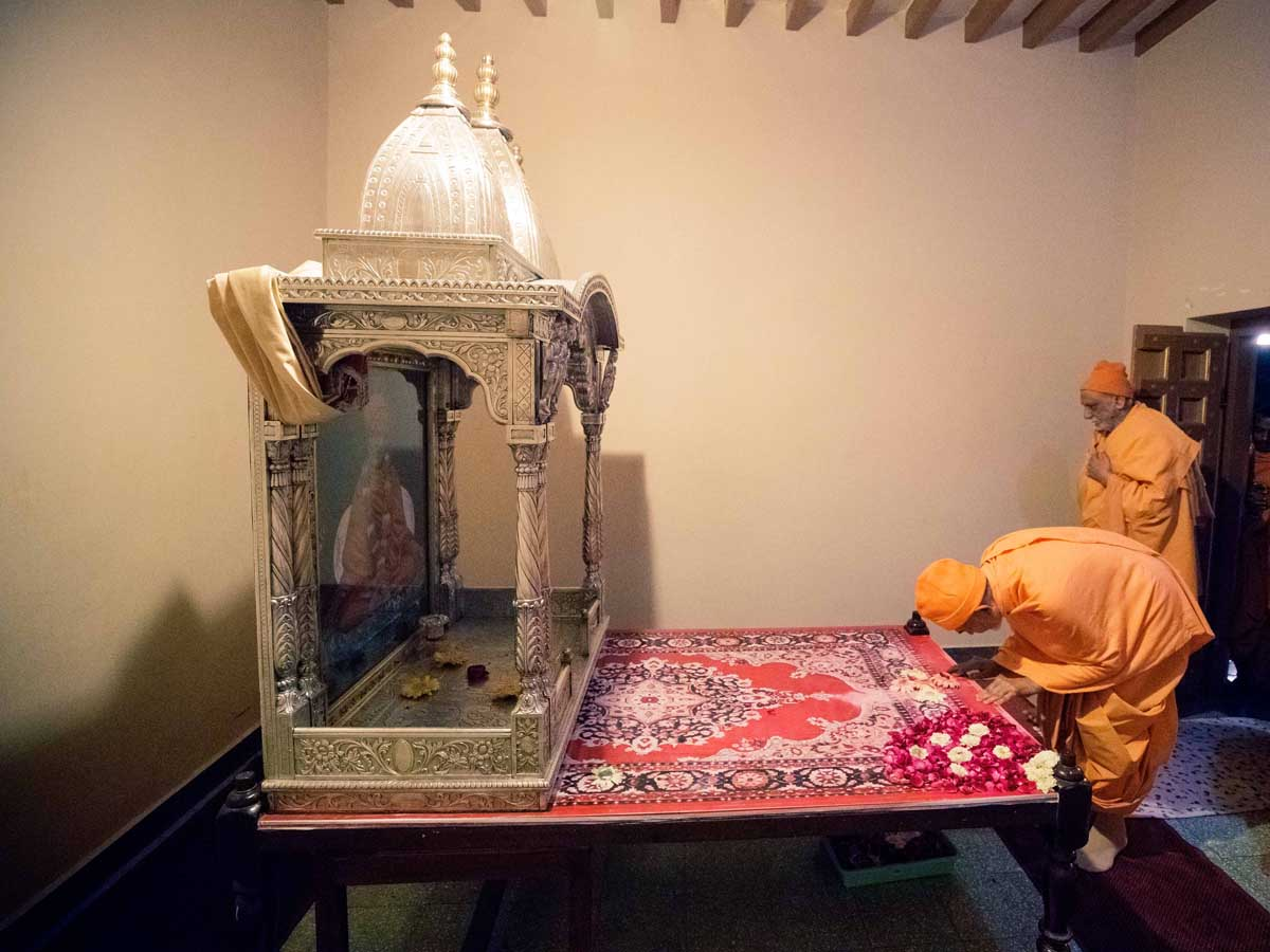 Swamishri engrossed in darshan of Shastriji Maharaj's room