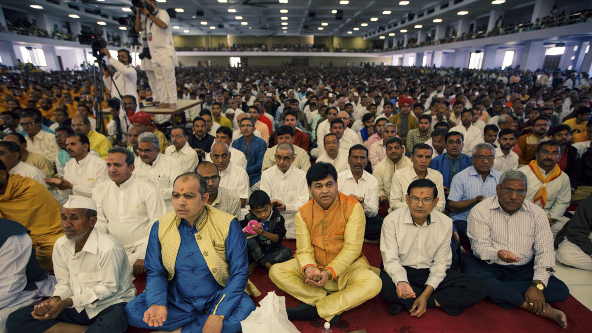 Fathers of the sadhaks participate in mahapuja rituals