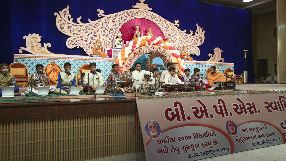 Children sing kirtans in the evening Annual Day assembly of the BAPS Swaminarayan Chhatralaya, Gondal