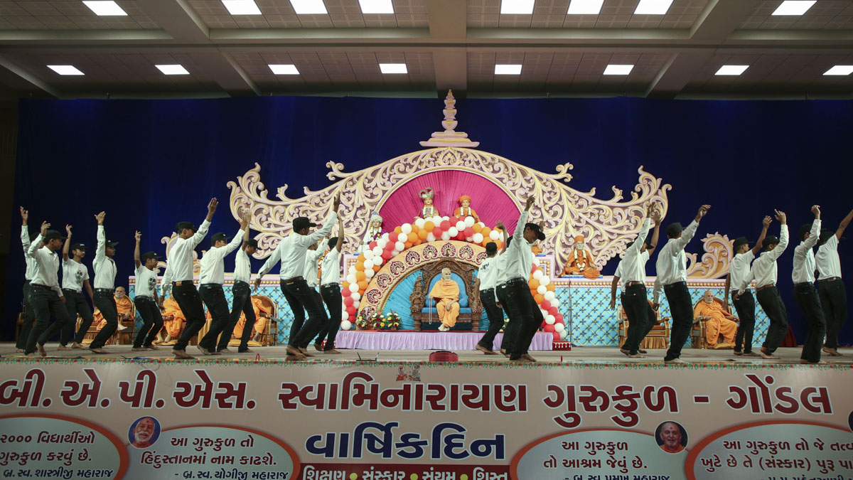 Students perform a thematic dance in the assembly