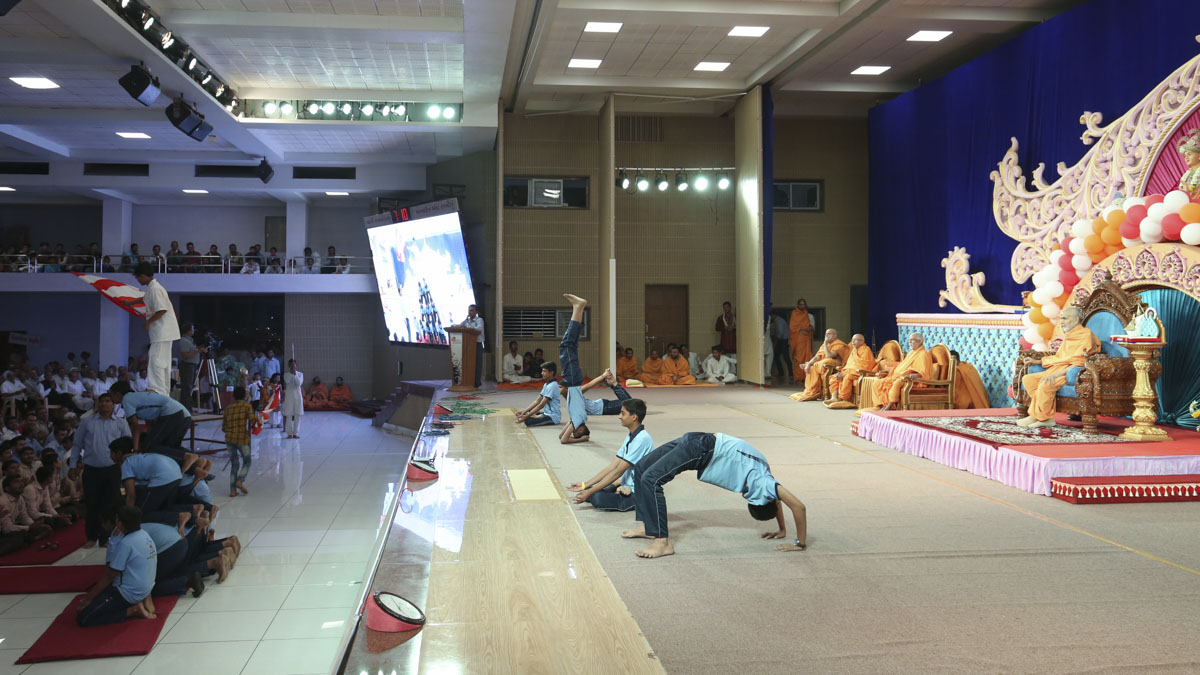 Students perform yoga asanas