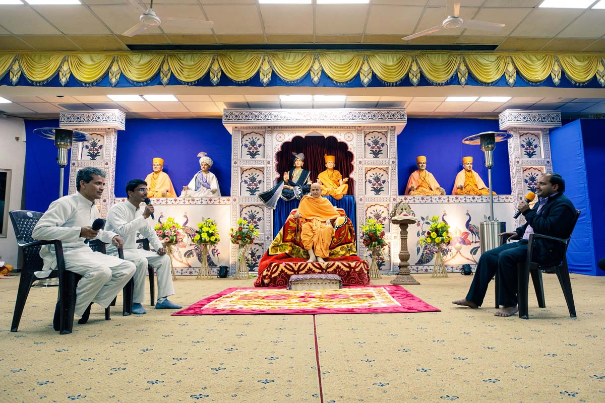 Youths present before Swamishri in the evening lunar eclipse assembly