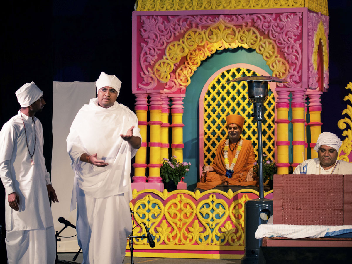 Youths present a skit in the evening satsang assembly