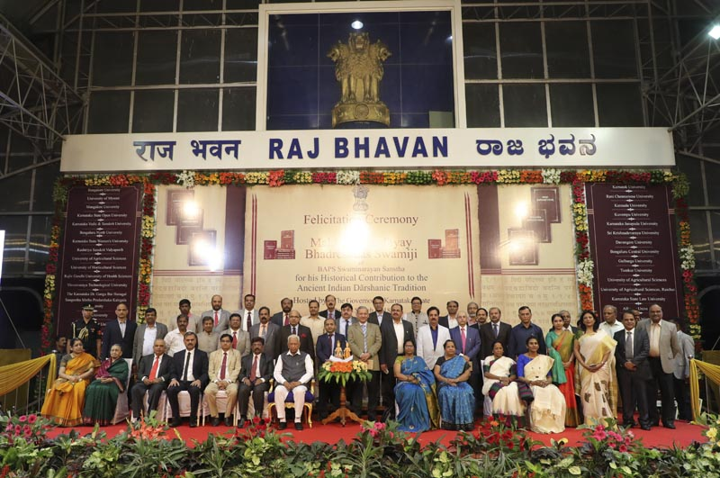 The Governor of Karnataka, His Excellency Vajubhai Vala, together with the university vice-chancellors and representatives