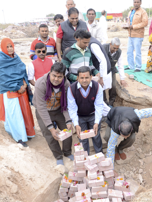 Devotees and well-wishers place sanctified bricks