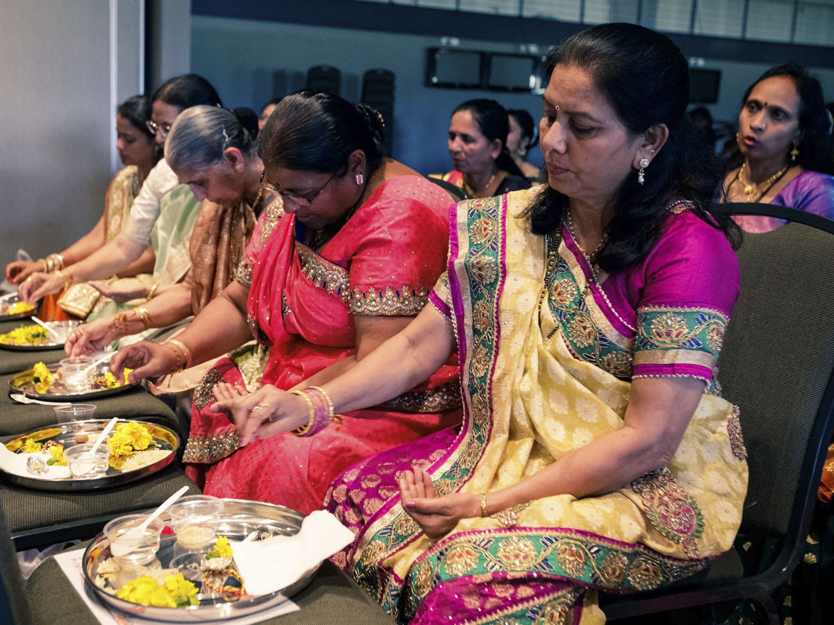 Relatives of sadhak participate in mahapuja rituals