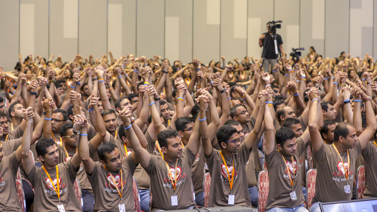 Youths join the hands in a gesture to show unity