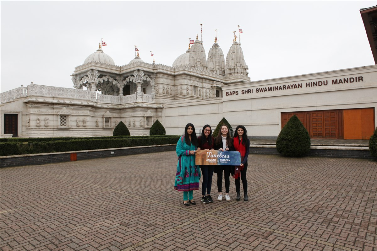 Friends take photo mementoes upon arrival at the Mandir