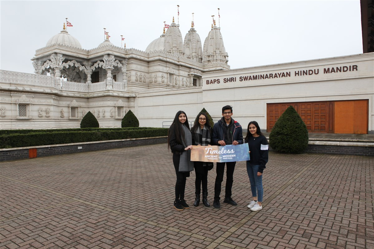 Friends take photo mementos upon arrival at the Mandir