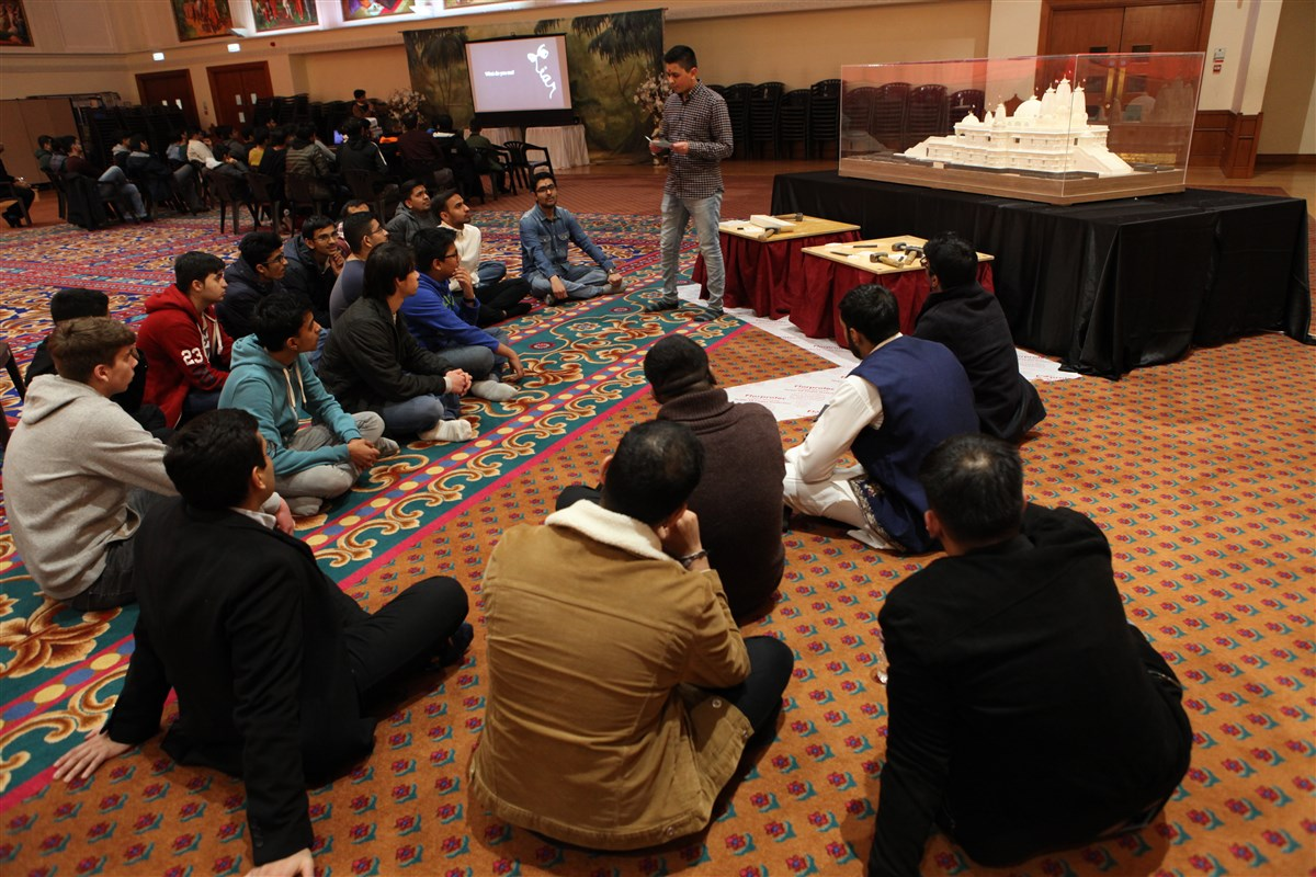 A youth explains the history of the Mandir