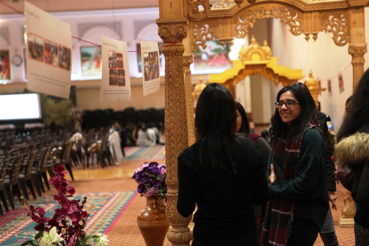 Delegates learn about some of the youth activities at the Mandir