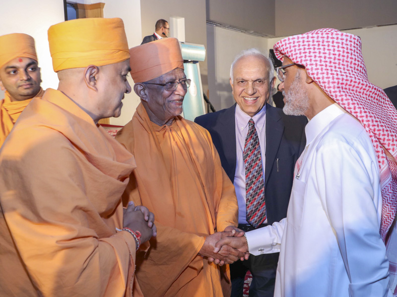 Pujya Doctor Swami greets a guest