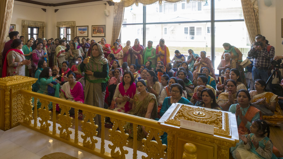 Women devotees doing darshan of the newly consecrated murtis