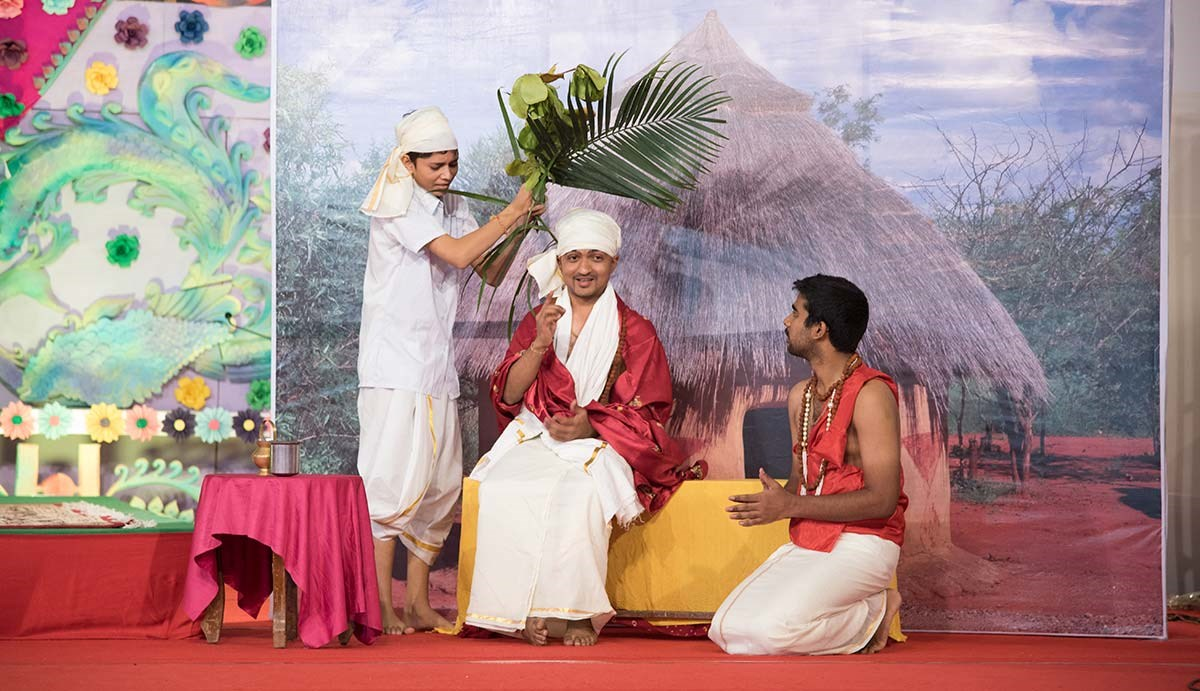 Children perform a skit in the evening satsang assembly