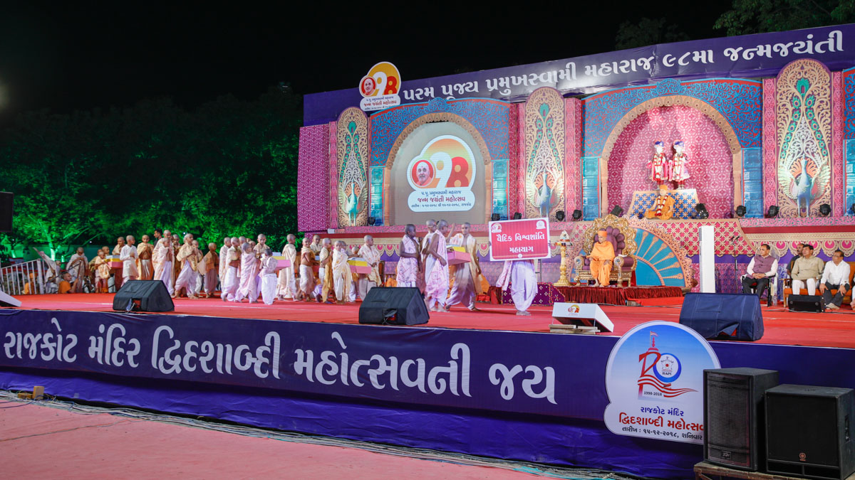 Children present a parade to display the various events that will be held throughout the year as part of the 98th birthday celebrations of Pramukh Swami Maharaj