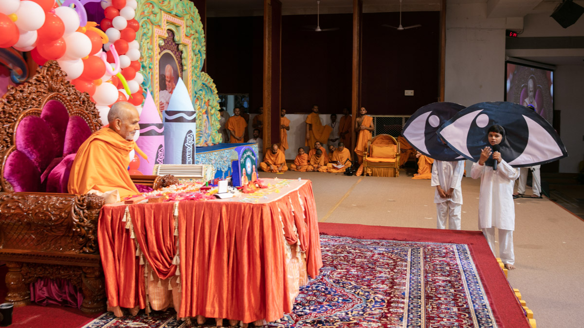 Students present before Swamishri