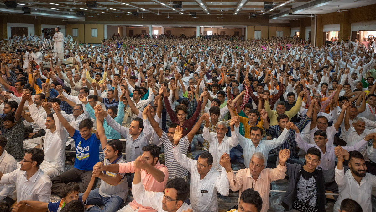 Devotees join hands in a gesture of unity