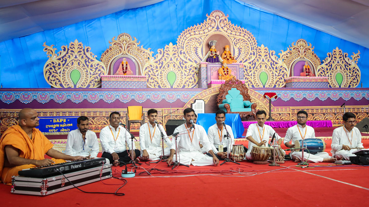 Youths sing kirtans in the evening assembly