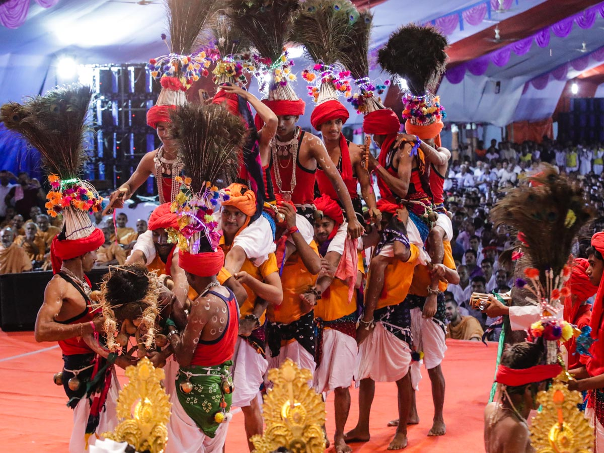 Devotees perform a tribal dance