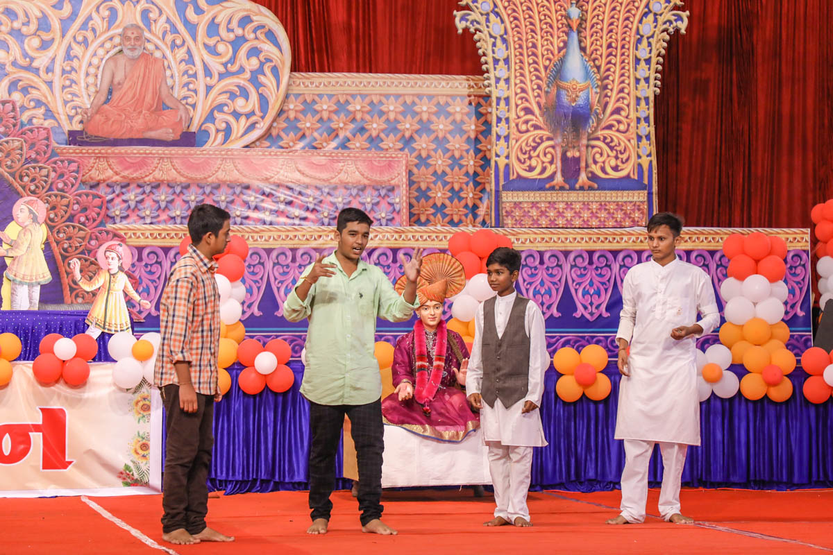 Children perform a skit in the evening Bal Din assembly