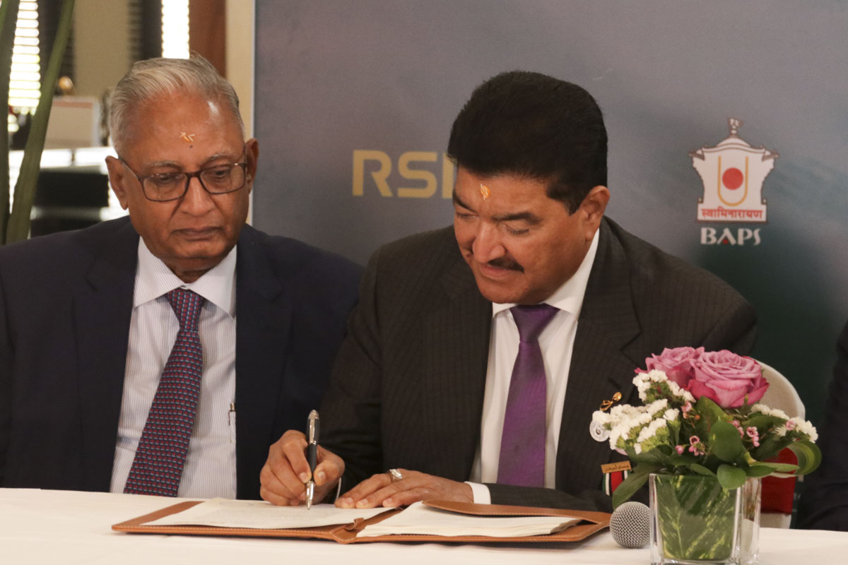 Dr. B.R. Shetty signs the contract