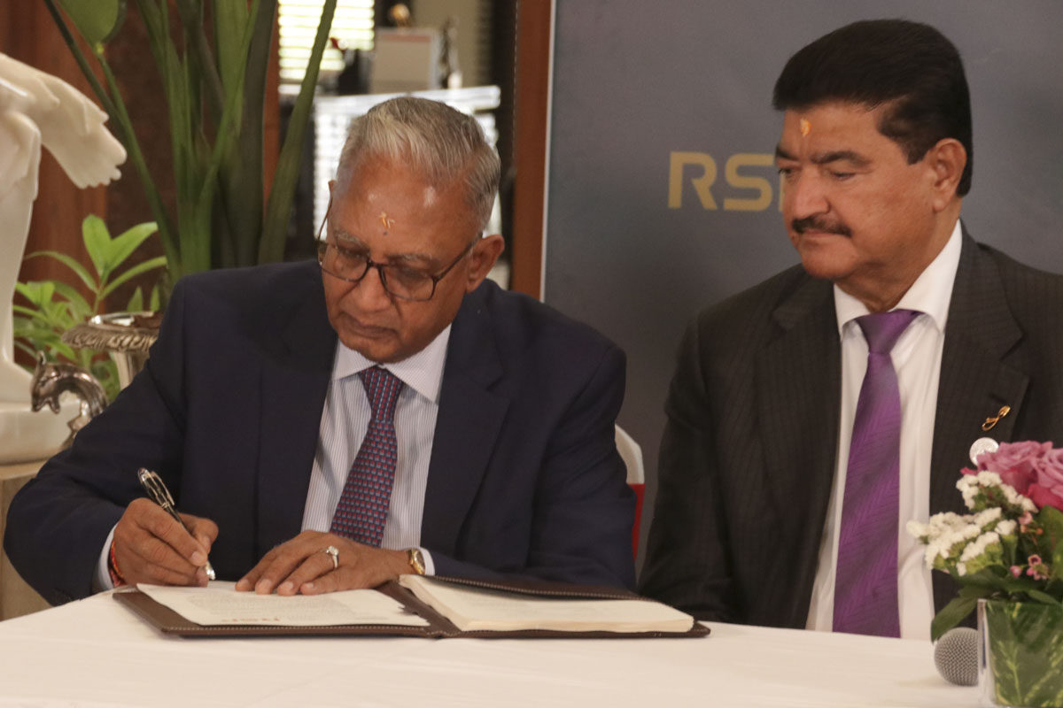 Mr. Rohit Patel signs the contract