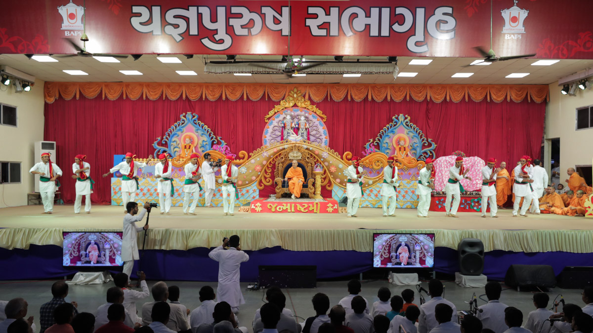 Youths perform a dance in the evening symbolic Krishna Janmashtami celebration assembly