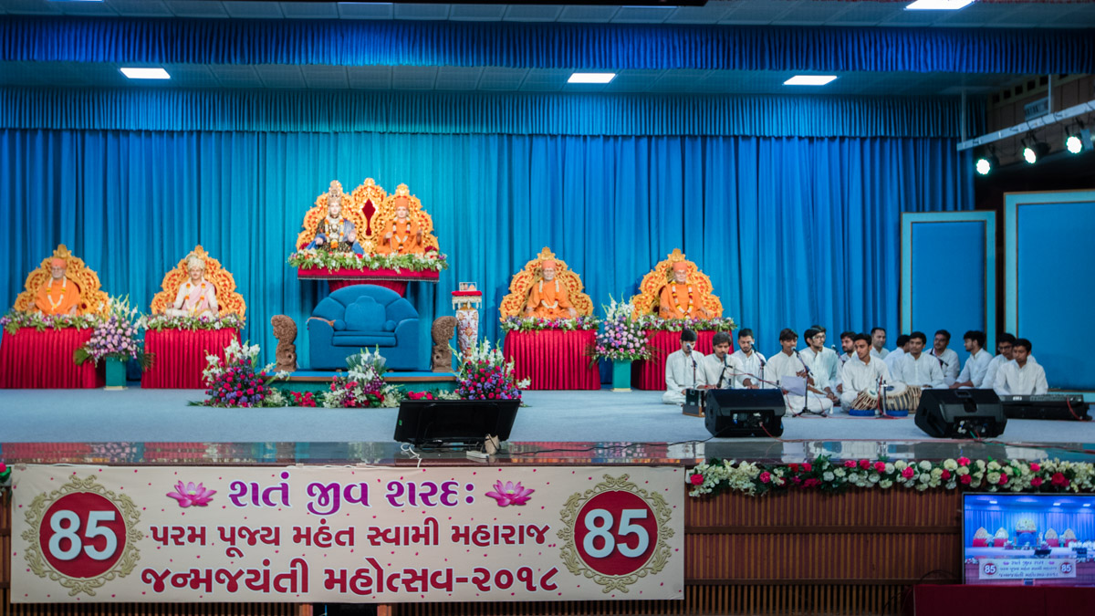 Youths sing kirtans in the evening assembly celebrating HH Mahant Swami Maharaj's 85th Birth Anniversary
