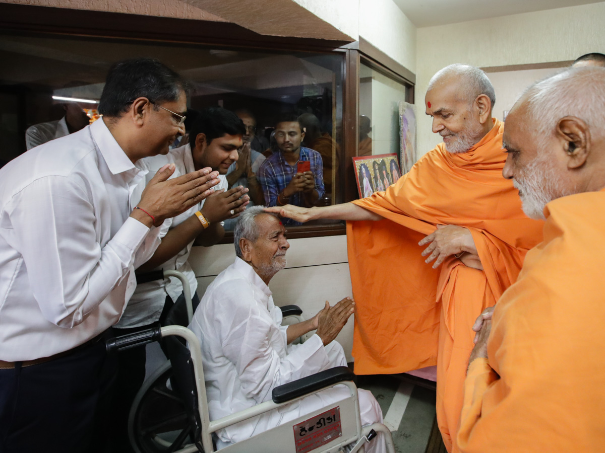 Swamishri blesses an ailing devotees