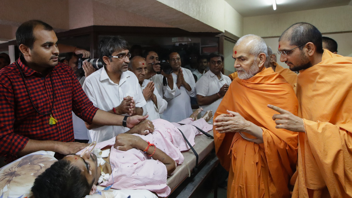 Swamishri blesses an ailing youth