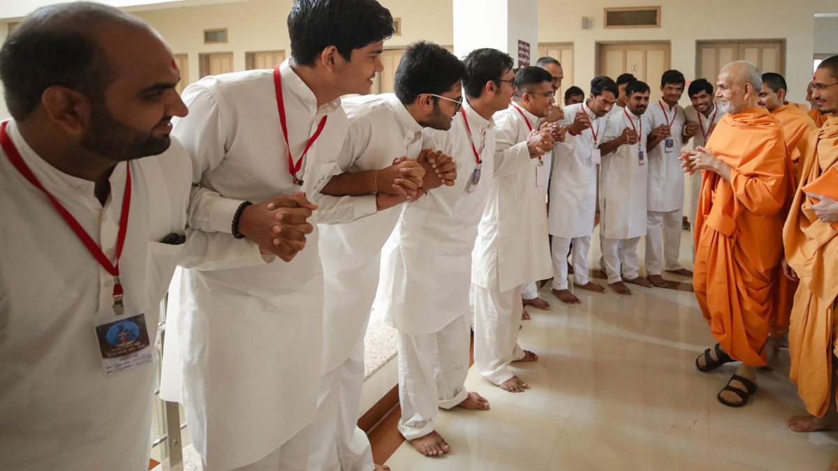 Youths join hands in a gesture of unity