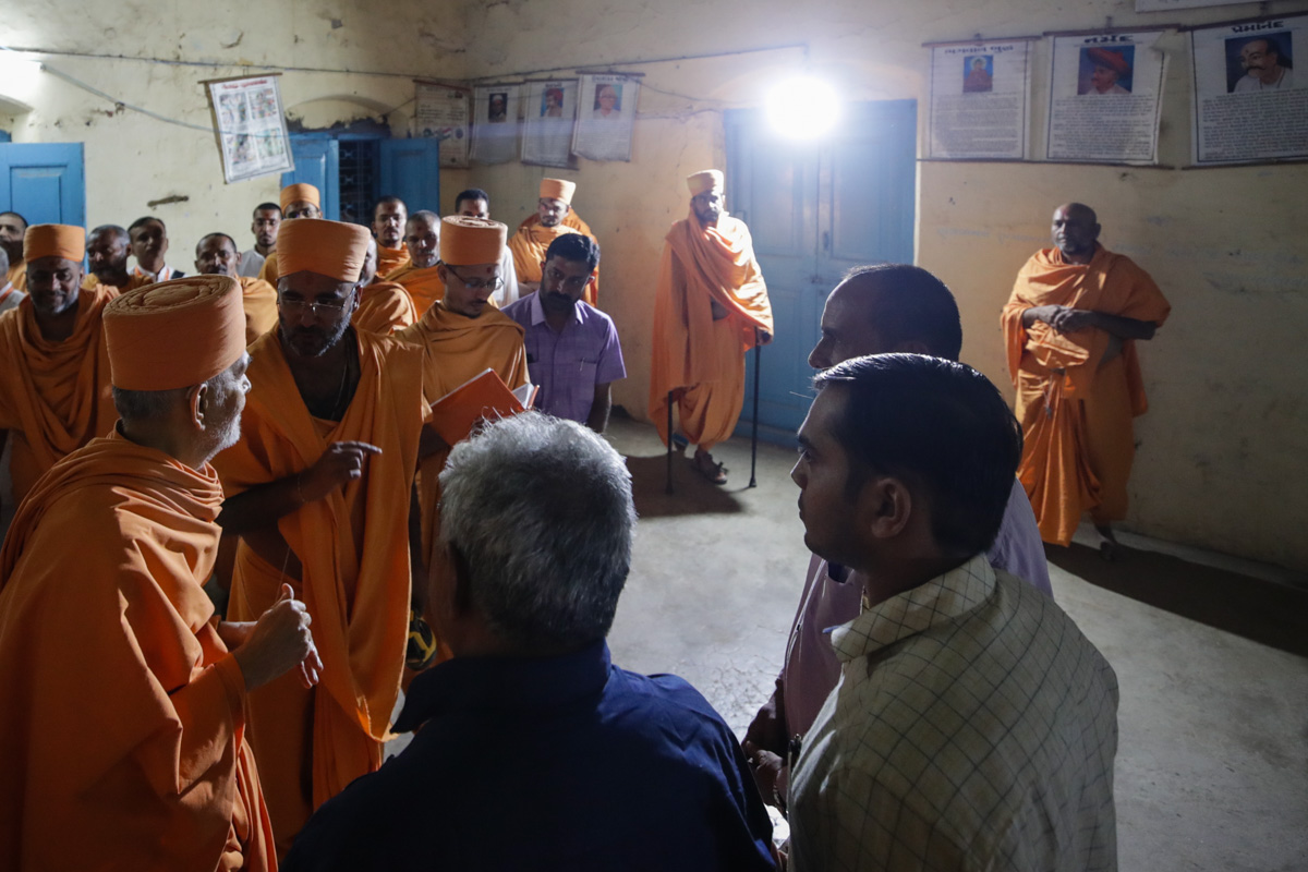 Swamishri and sadhus inside a classroom