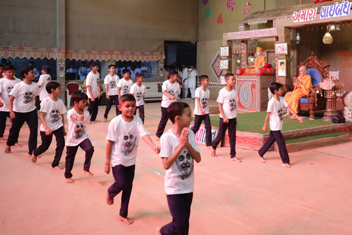 Children perform a dance