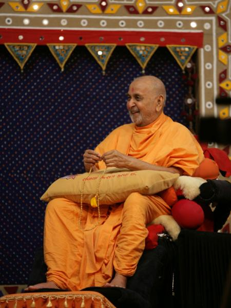 Swamishri in a divine, jovial mood during the drama presentation